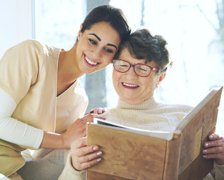 senior woman and woman smiling