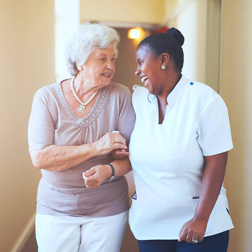 happy caregiver with senior woman