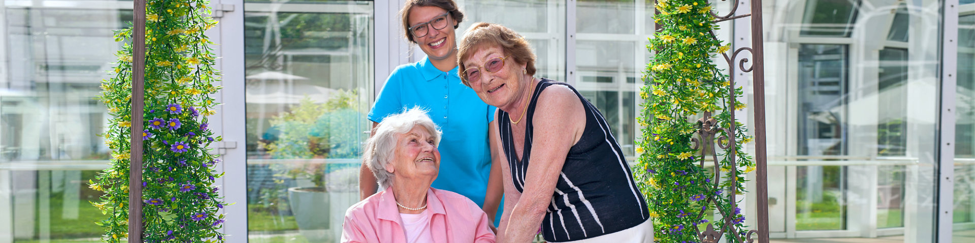 happy seniors with caregiver